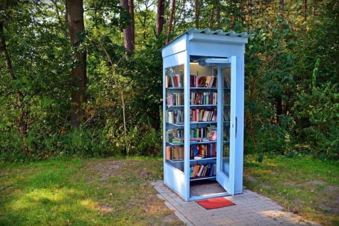 phone booth repurposed as a free community library