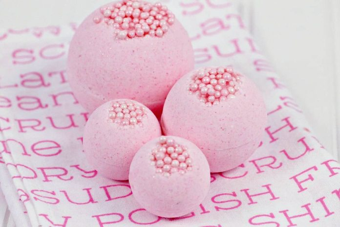 Bubble Gum Bath Bombs displayed on pink and white fabric