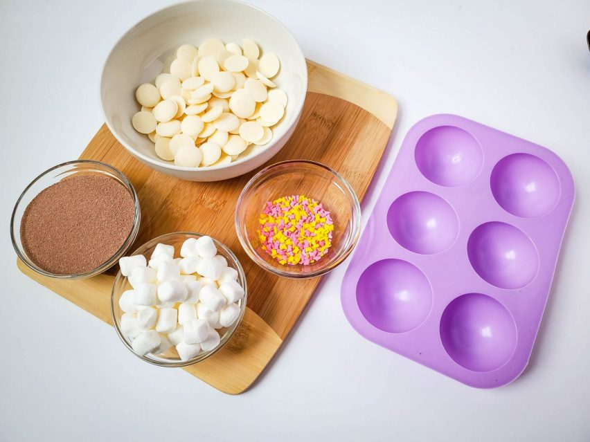 Ingredients and supplies to make white chocolate cocoa bombs