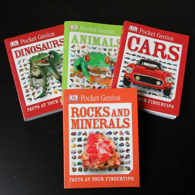 @DKCanada Pocket Genius books. Dinosaurs, Animals, Cars, and Rocks & Minerals are fanned out on a tabletop